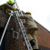 During night raids police use fire service ladders to enter into the houses